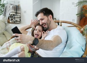 father and daughter selfie
