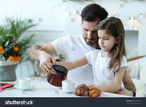 father and daughter having tea