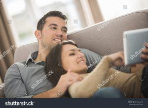 homeowner couple on ipad/tablet