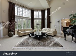 spacious living room for homeowners with 2 storey windows