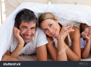 homeowners having fun under bed sheets