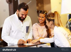 young businessman signing