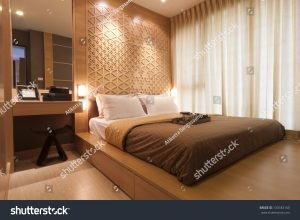 bedroom decorated with wood and warm light